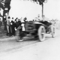 Car No. 3 passes crowd during a Vanderbilt Cup Race on Motor Parkway