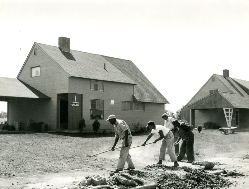 Crew working on lawn of a Levitt house