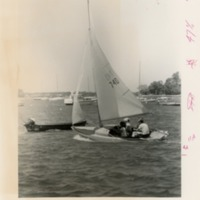 Four people in a small sailboat